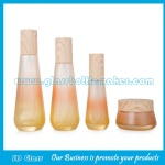 New Items 40ml,100ml,120ml,50g Colored Glass Lotion Bottles And Cosmetic Jars With Wood Caps For Skincare